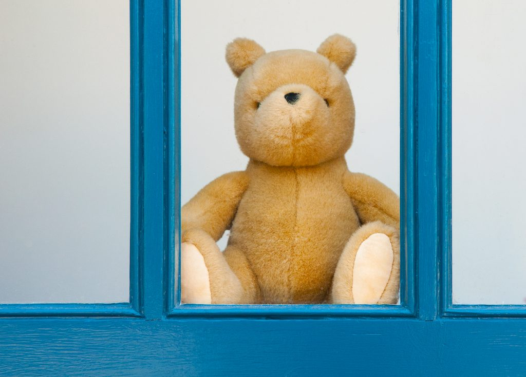 Help create a bear hunt by putting a stuffed teddy bear in a window of your home and then kids can look for them on their walks. Photo by Allison Potter