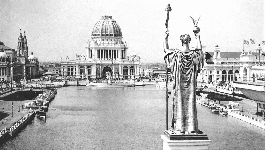 The Republic statue overlooks the Grand Basin and the Administration Building of the World's Columbian Exposition, the 1893 World's Fair held in Chicago. Elco boats can be seen docked and motoring about the pool.