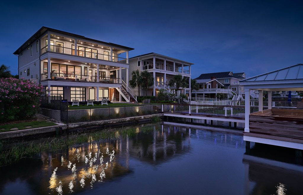 A slow, nocturnal cruise around Harbor Island brings boaters past this three-story Lees Cut home, one of several that represents a real estate renaissance along Harbour Island's Pelican Drive. Michael Blevins/MB Productions NC.