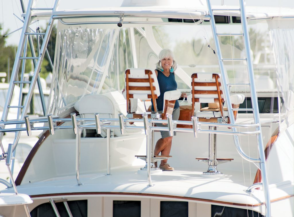 Pat Bradford photographed at the helm of Wrightsville Beach's Trial Size, a 61-foot Garlington owned by Phillip David, for our June 2018 issue. | Allison Potter.