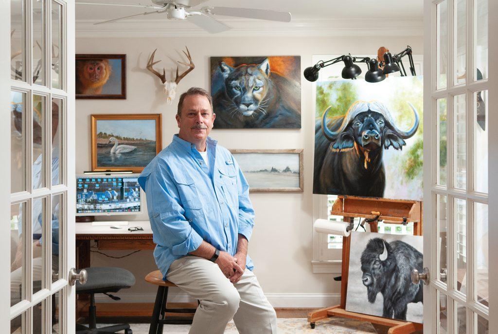 Artist David Starbuck paints in his home studio on Harbor Island. Allison Potter.