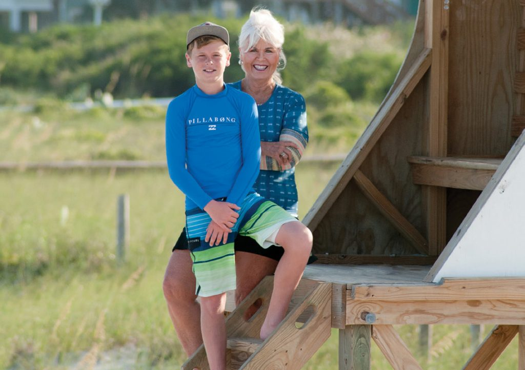 Pat Bradford and grandson Ethan in 2017, photographed in WB stand #12 by Allison Potter. Ethan participated in Jeremy Owens's Ocean Rescue Junior Lifeguard camp two memory-filled summers, 2017-2018. WB file photo.