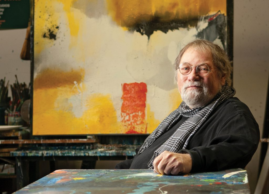 Dick Roberts co-founded Acme Art Studios in downtown Wilmington with six other artists in 1991. The large easel in his space there supports Helios, a 47 x 47 inches oil and mixed media piece. Allison Potter