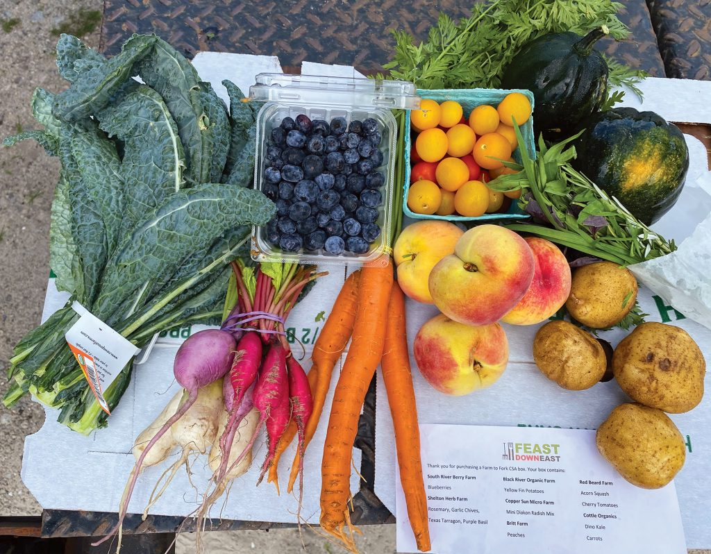 Feast Down East distributes fresh local produce through its Farmto- Fork Community Supported Agriculture Boxes, March through August. Colleen Worrell