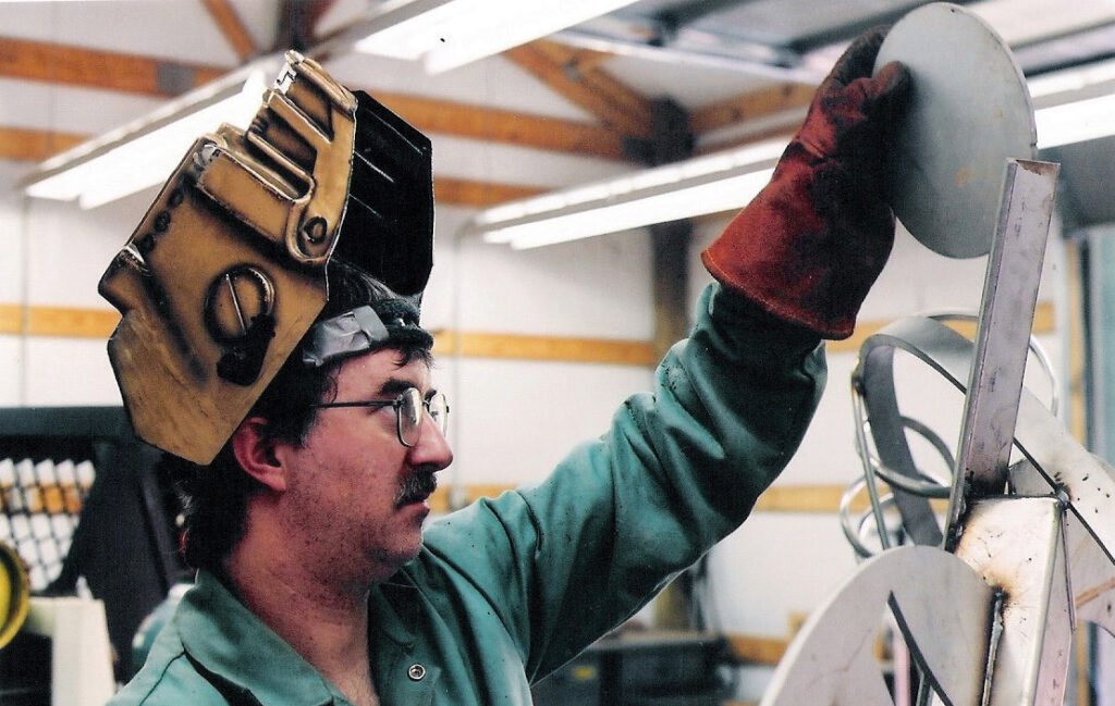 Tom Risser welds a sculpture in his studio circa 2006. Daisy Risser.