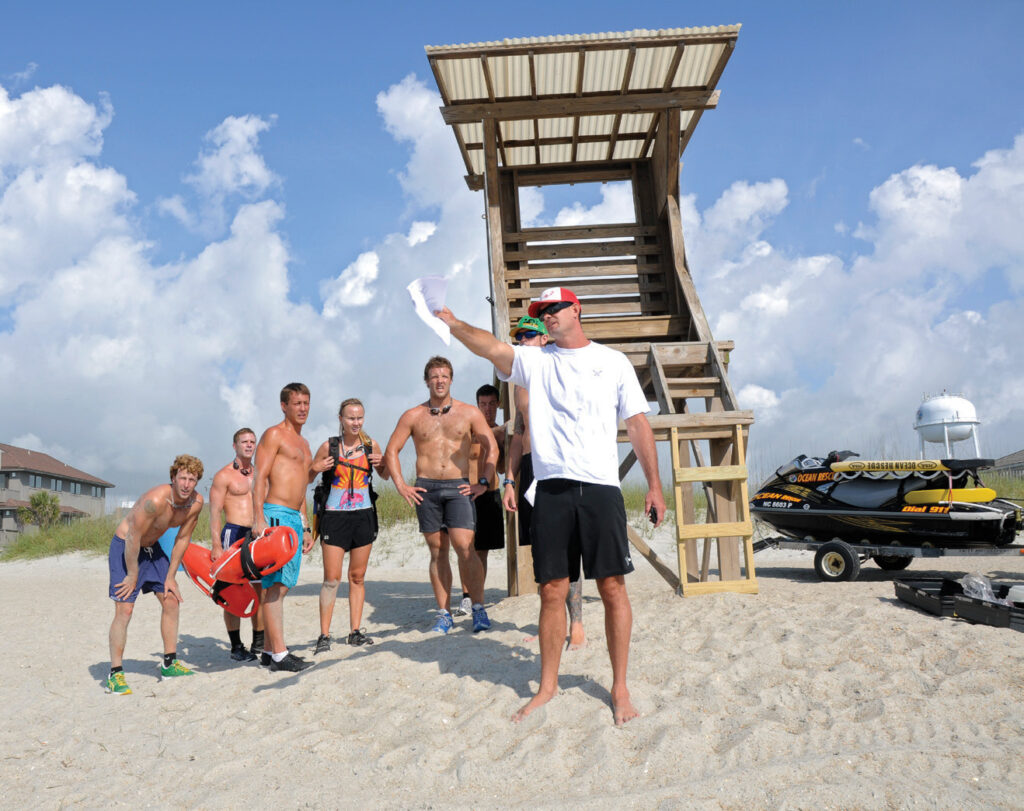 Wrightsville Beach Ocean Rescue captain Jeremy Owens directs a team on its next task during the grueling Lifeguard Challenge in May 2012. WBM file photo.
