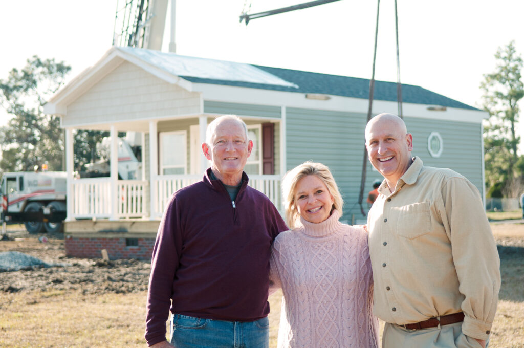 Tom Brown, left, and Kim and Tom Dalton of Eden Village were on site at Kornegay Avenue to see the arrival of the nonprofit's first home in Wilmington on January 13, 2021. Allison Potter.