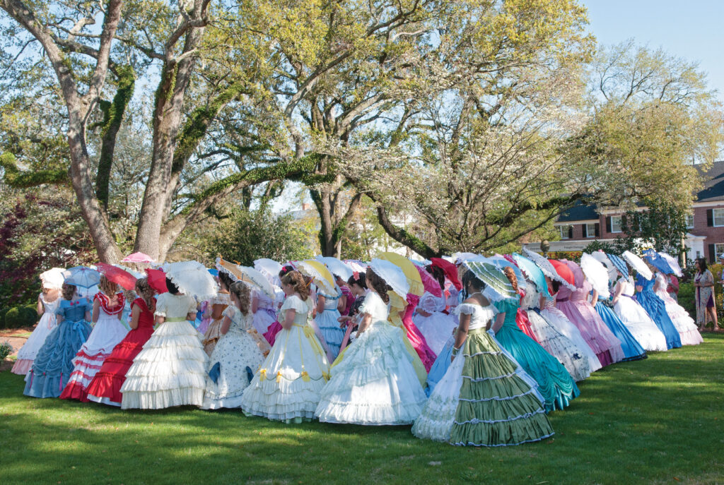 The Azalea Belles® gather on the Kenan House lawn for a group photo during the 2019 belle tea. WBM File Photo