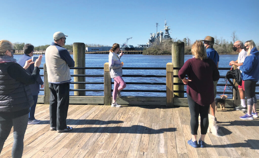 Taylor Henderson of Cape Fear River Watch leads an informative guided tour along and near the Riverwalk in downtown Wilmington in February. Photo Courtesy of Cape Fear River Watch