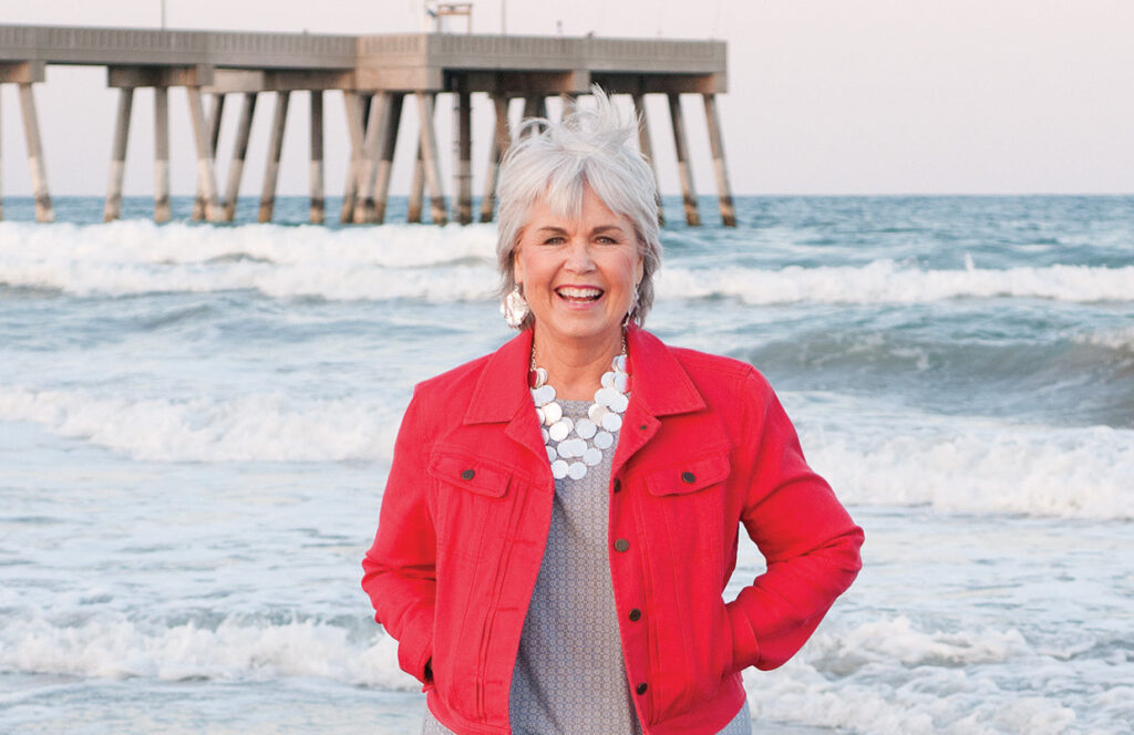 Pat Bradford strolls the beach by Johnnie Mercers Pier for our June 2014 issue. WBM File Photo