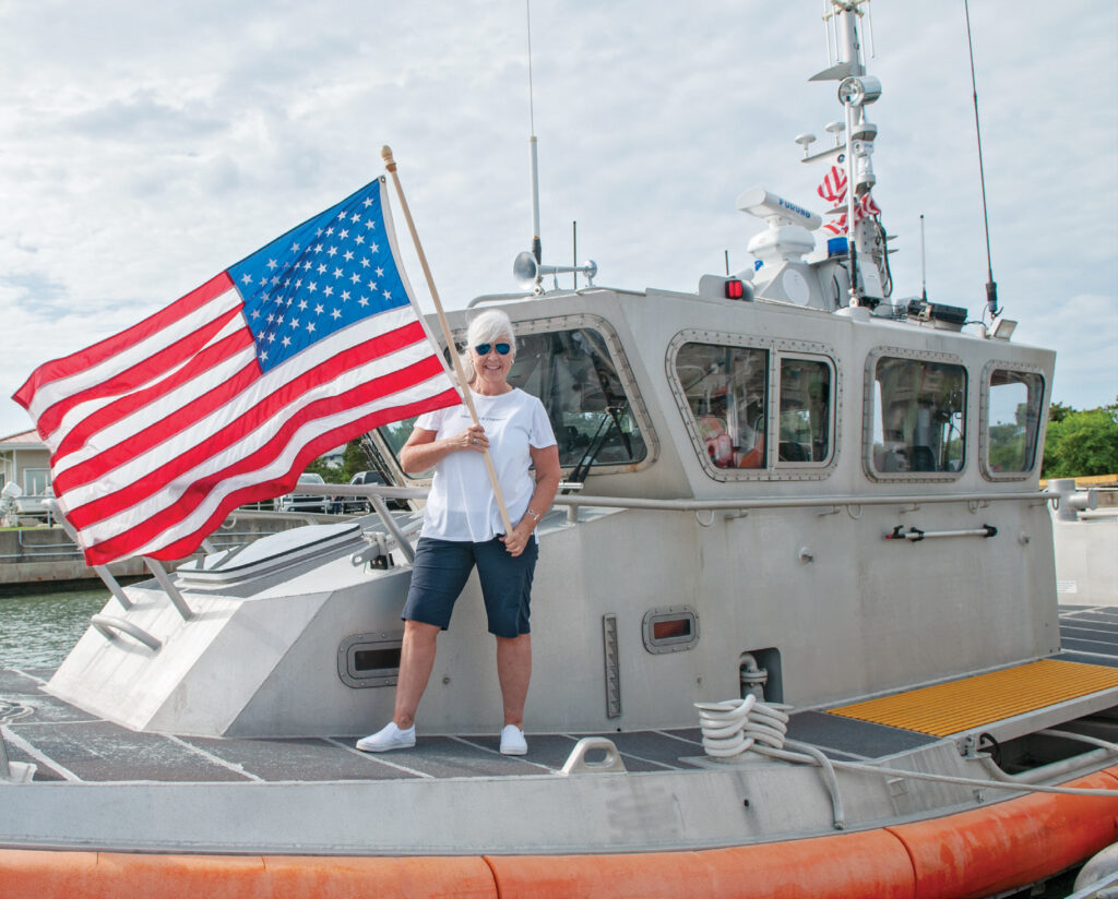 Pat Bradford flies our nation's flag aboard the 45-foot response boat at United States Coast Guard Station Wrightsville Beach before boarding the 29-foot boat for our cover shoot. Photo by Allison Potter