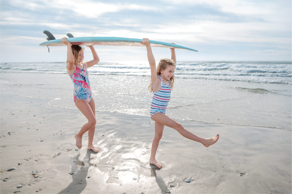 Soaking up summer at Wrightsville Beach: Sisters Olivia (left) and Emily play at Wrightsville Beach during their summer break. Photo by Allison Potter