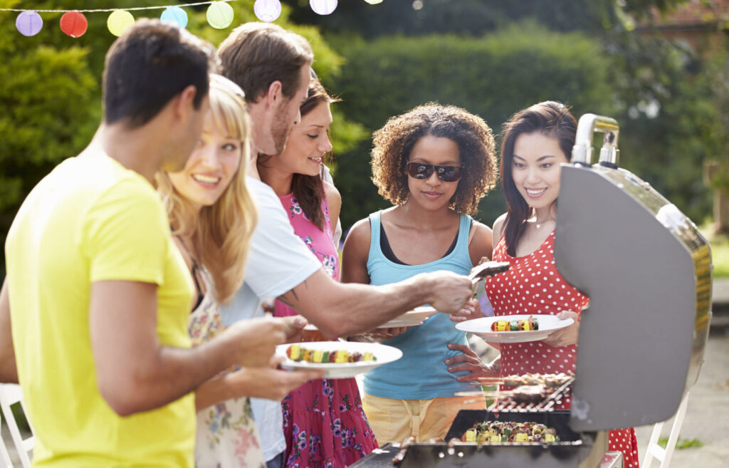 31011539 - group of friends having outdoor barbeque at home