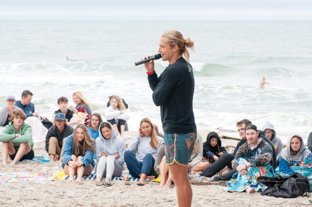 Mark Johnson (above) and Kyle Sullivan (opposite), both pastors and surfers, speak at Wrightsville Beach Surf Church, just north of Crystal Pier, on May 30. Photo by Allison Potter