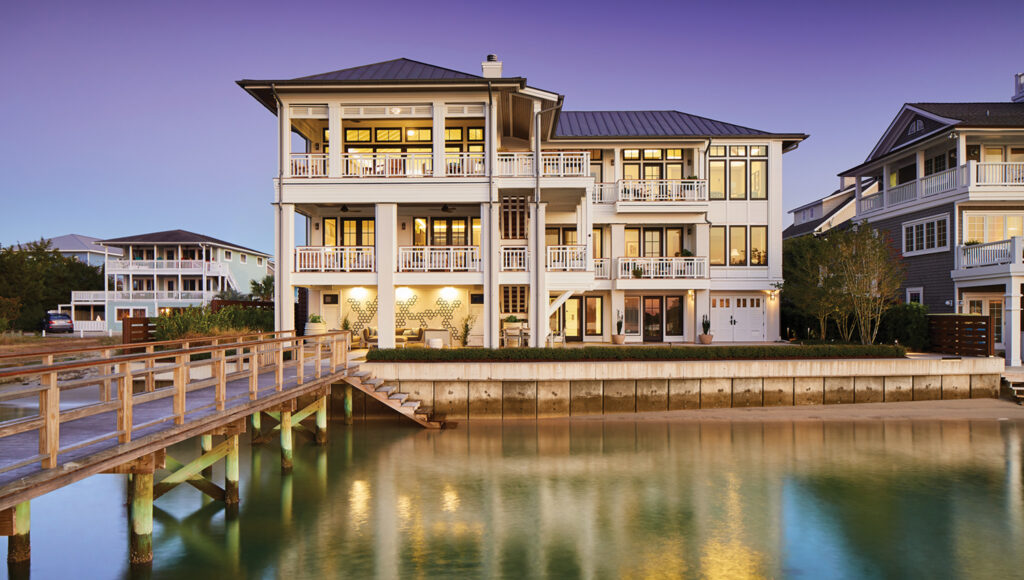 The sound-facing side of the residence appears to rise out of the water, reflecting the owners' vision for making the home feel like an extension of their dock. Photo by Michael Blevins/MB Productions NC