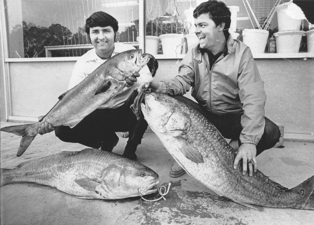 Mike Merritt and Jack Talbert pose with their red drum and bluefish caught at Hutaff Island circa 1970. Photo courtesy of Donna Starling