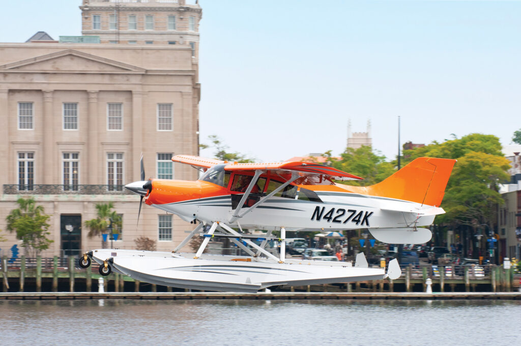 Former airline pilot, certified flight instructor and FAA Designated Pilot Examiner, David Lackey lands his Maule M-7-260 seaplane on the Cape Fear River in downtown Wilmington on August 2, 2021. Photo by Allison Potter