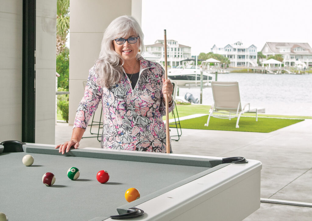 Pat Bradford enjoying a nostalgic moment at the home of Bobby and Cindy Lewis on Wrightsville's Lollipop Bay.  Pat's hair by Frank Potter, styled by Lola Lazarus, makeup by Regan Daughtry. Photo by Allison Potter.