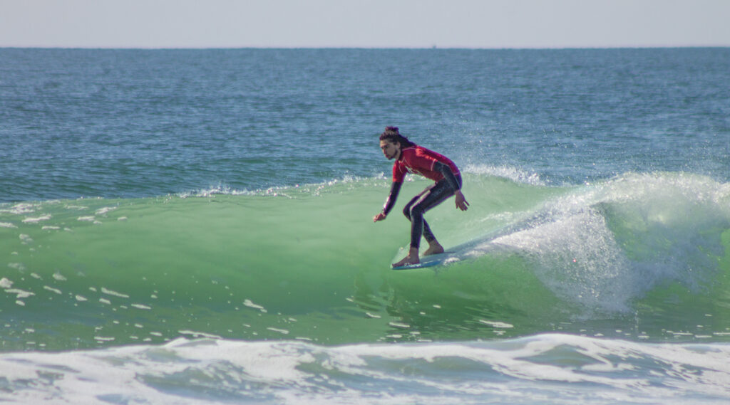Brennan Plotner rides the nose at the 2015 Wrightsville Beach Longboard Association's Pro-Am Longboard Surf Contest. Photo by William Love